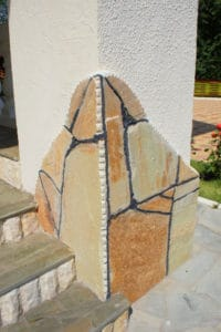 Облицовка фасада дома Златолитом